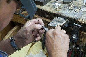 Jeweler making earring